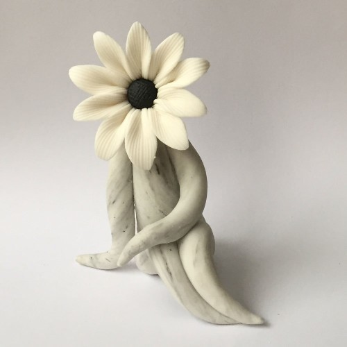 Black daisy flower lady sculpture