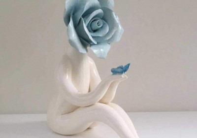 turquoise rose sculpture - flower lady
