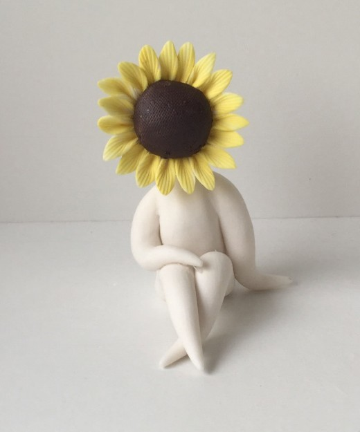 Little Miss Sunflower is handmade in parian clay.