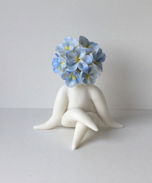 miss forget me not flower sculpture