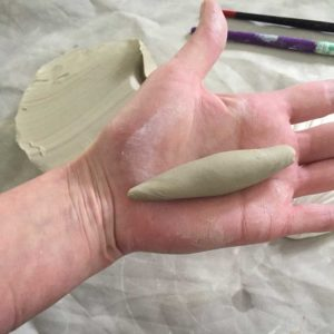 clay rolled to a pointy sausage