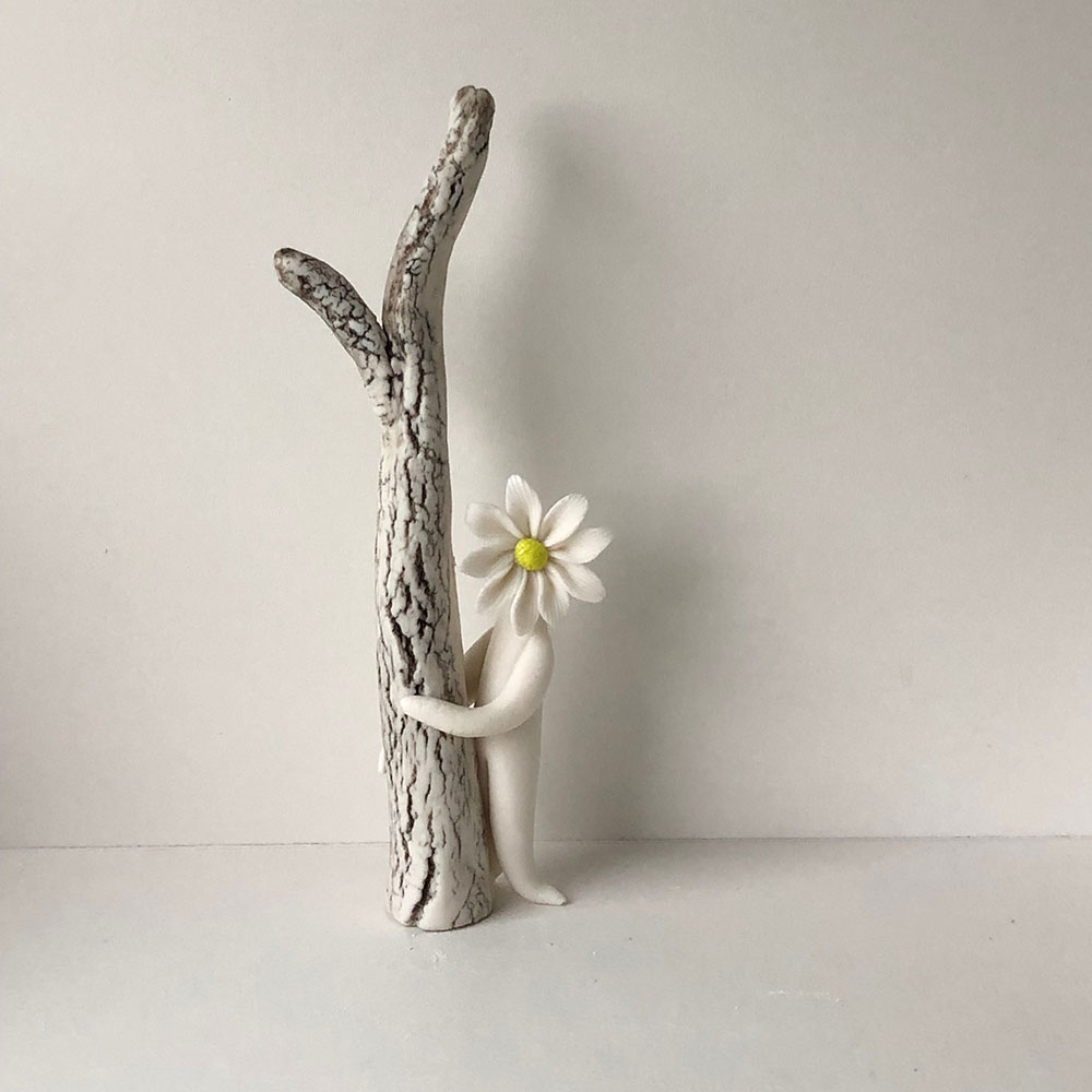 daisy lady by tree