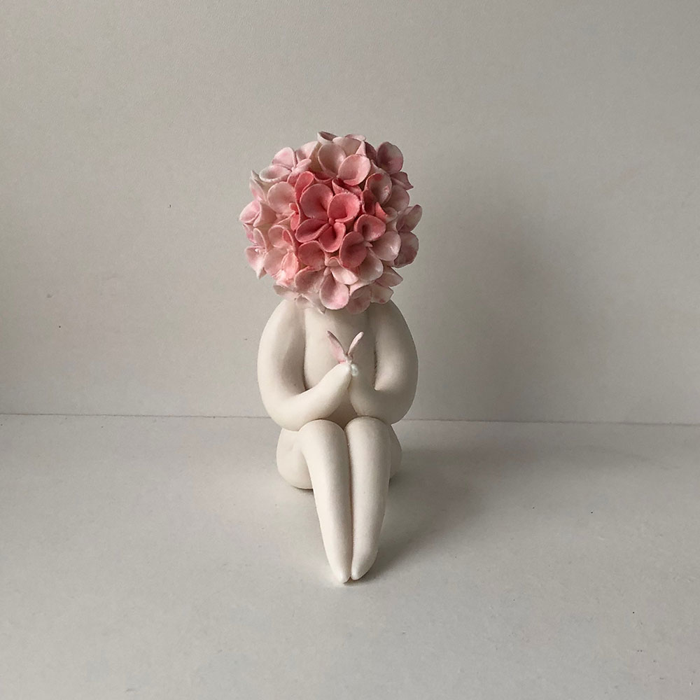 surrealism art sculpture, flower headed sculpture