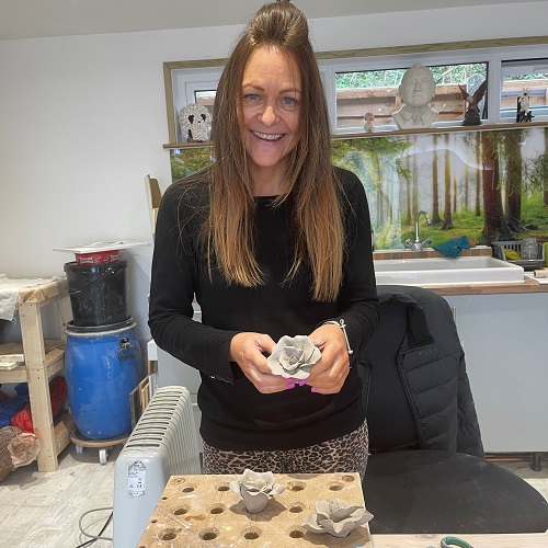 Vicky Walker Proudly Holding the clay flower she made