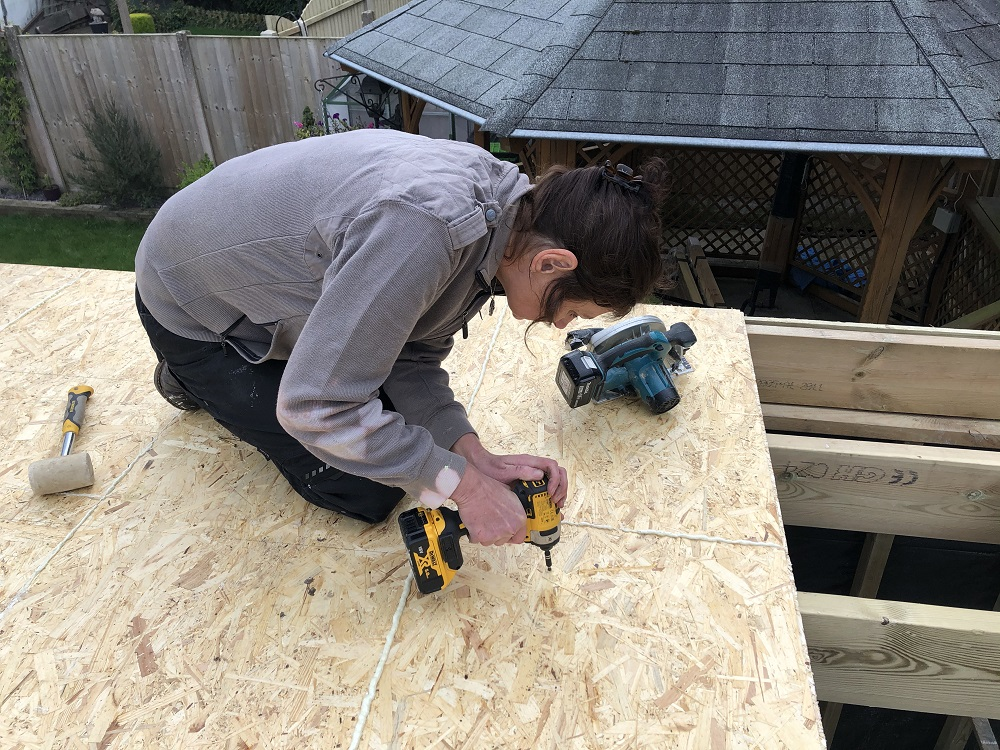 OSB being screwed to create roof